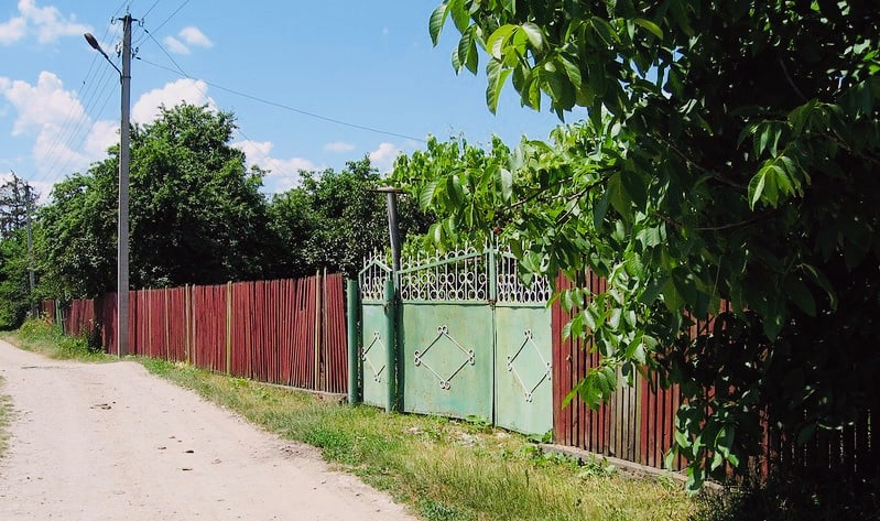 Green gate and red fence in Ivancea, Moldova