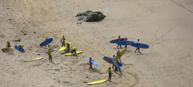 Surfers and boards at the beach in Newquay, Cornwall