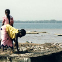 Girls drying fish along the Diouloulou River in Casamance, Senegal